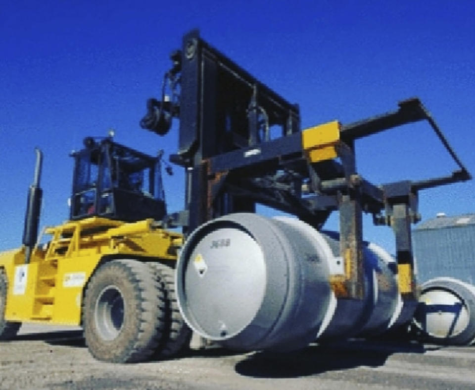 In this photo released on Wednesday, Nov. 6, 2019 by the Atomic Energy Organization of Iran, a lift truck carries a cylinder containing uranium hexafluoride gas for the purpose of injecting the gas into centrifuges in Iran's Fordo nuclear facility. Iran will start injecting uranium gas into over a thousand centrifuges at a fortified nuclear facility built inside a mountain, the country's president announced Tuesday in Tehran's latest step away from its atomic accord with world powers since President Donald Trump withdrew from the deal over a year ago. (Atomic Energy Organization of Iran via AP)