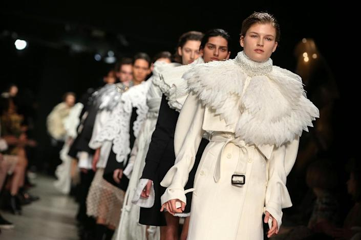 Models present creations from the Burberry collection featuring ropped couture capes made of white feathers to black jewels, glass crystals, clear plastic, tassels, pearls and beads on the fourth day of the Autumn/Winter 2017 London Fashion Week (AFP Photo/Daniel LEAL-OLIVAS)
