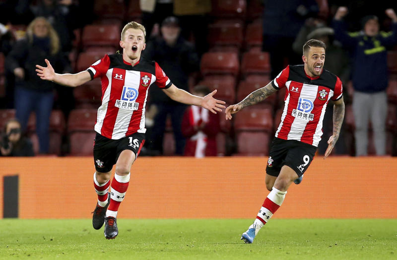 Southampton's James Ward-Prowse, left, celebrates scoring against Watford during the English Premier League soccer match at St Mary's Southampton, England, Saturday Nov. 30, 2019. (Mark Kerton/PA via AP)