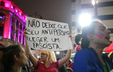"""Demonstrators shout slogans against Jair Bolsonaro, far-right lawmaker and presidential candidate of the Social Liberal Party (PSL), during a protest called """"against fascism"""" in Sao Paulo, Brazil October 11, 2018. The poster reads: """"Don't allow your anti-Workers Party (PT) to elect a fascist."""" REUTERS/Amanda Perobelli"""