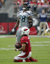Arizona Cardinals quarterback Kyler Murray (1) kneels on the turf after being tackled by Seattle Seahawks defensive end Rasheem Green (98) during the first half of an NFL football game, Sunday, Sept. 29, 2019, in Glendale, Ariz. (AP Photo/Rick Scuteri)