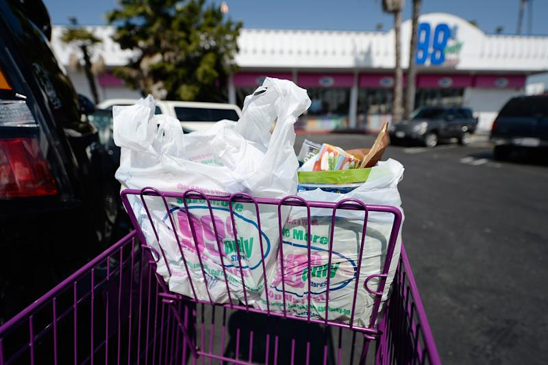Shoppers use plastic grocery bags after shopping at the 99 Cents Only Store in Los Angeles, California.