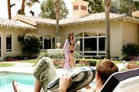 <p>Complete with a drink in hand, Kendall Casablancas (Charisma Carpenter) knows how to turn heads.</p>