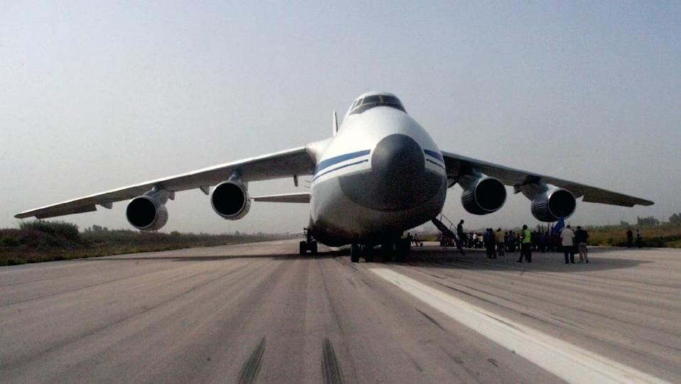 A handout picture released by the Syrian Arab News Agency on September 12, 2015 shows a Russian plane carrying humanitarian aid being unloaded on the tarmac of the airport in Latakia (AFP Photo/)