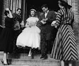 <p>This circa-1955 couple leaves the church to the well wishes of friends and family for a truly timeless send-off. The bride's full-skirted dress still looks adorable to modern eyes. </p>