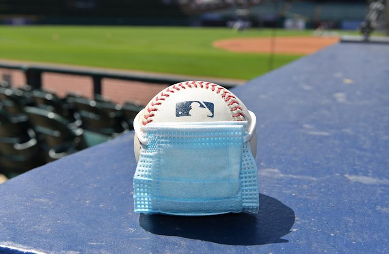 A baseball wearing a small surgical mask.