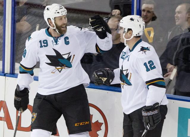 San Jose Sharks' Joe Thornton (19) and Patrick Marleau (12) celebrate a goal against the Edmonton Oilers during the second period of an NHL hockey game Friday, Nov. 15, 2013, in Edmonton, Alberta. (AP Photo/The Canadian Press, Jason Franson)