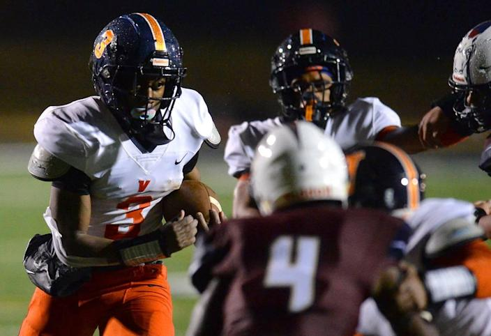 Vance Cougars running back Daylan Smothers, left, rushed for 162 yards and two TDs in Vance's 27-7 win over Mallard Creek Friday.