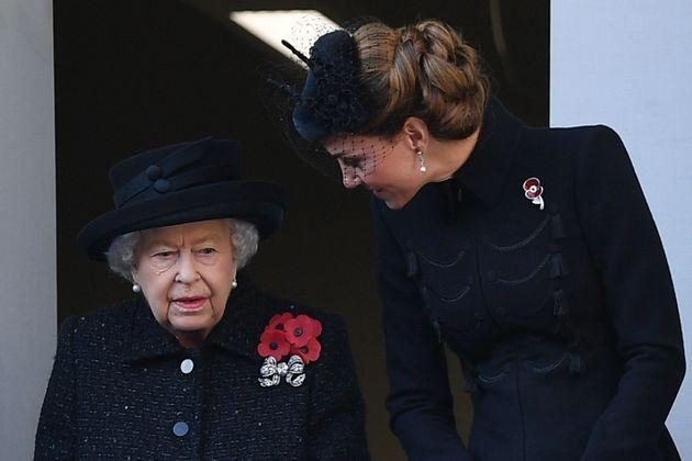 Britain's Queen Elizabeth II (L) talks with Britain's Catherine, Duchess of Cambridge, (R) as they attend the Remembrance Sunday ceremony at the Cenotaph on Whitehall in central London, on November 10, 2019. - Remembrance Sunday is an annual commemoration held on the closest Sunday to Armistice Day, November 11, the anniversary of the end of the First World War and services across Commonwealth countries remember servicemen and women who have fallen in the line of duty since WWI. (Photo by Daniel LEAL-OLIVAS / AFP) (Photo by DANIEL LEAL-OLIVAS/AFP via Getty Images)