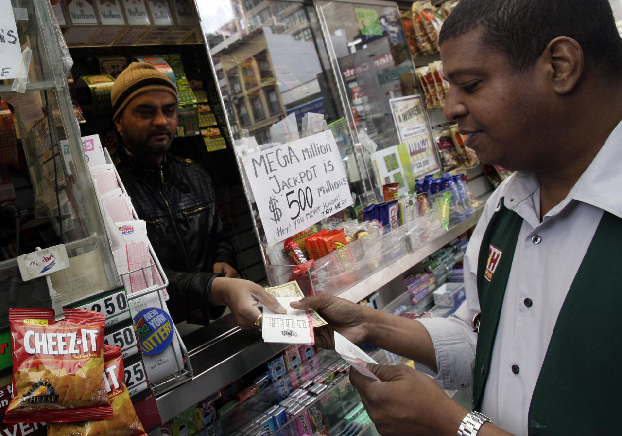 Mega Millions lottery contestant Hector Caminero buys $215 worth of tickets for Friday's $500-million game at a corner newsstand in New York, Thursday, March 29, 2012. Forget setting up a charity or establishing a trust, the winner of the $500 million Mega Millions jackpot could save teachers' jobs or help pay for Medicaid-funded doctor appointments in their home state just by paying taxes. (AP Photo/Richard Drew)