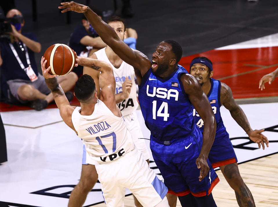 Argentina's Luca Vildoza (17) looks to pass as United States' Draymond Green (14) defends during the second half of an exhibition basketball game in Las Vegas on Tuesday, July 13, 2021. (Chase Stevens/Las Vegas Review-Journal via AP)