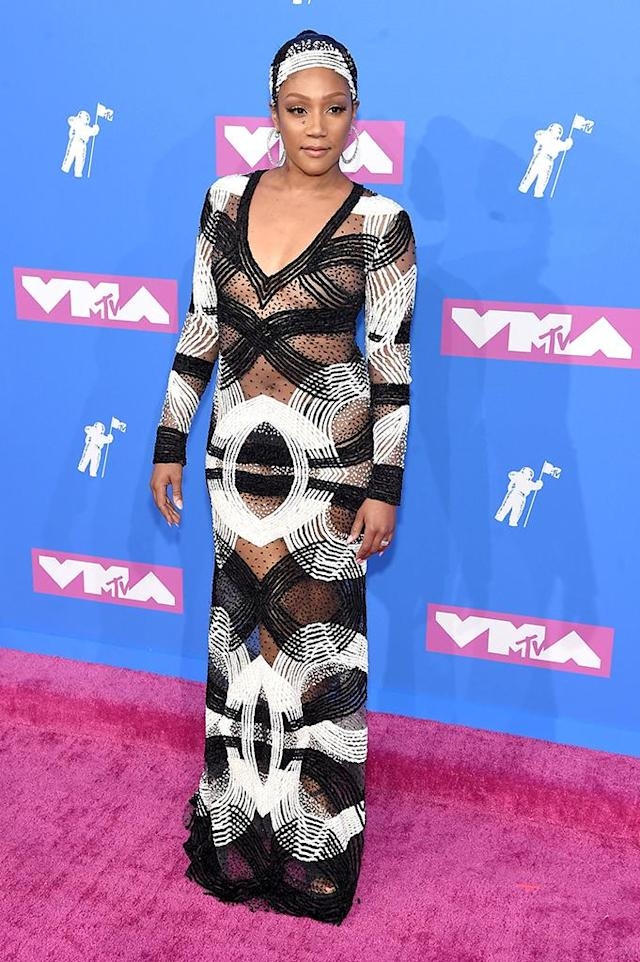 <p>She's ready! Haddish brought her hilarious jokes to the MTV VMAs crowd, with the help of a semi-sheer gown. (Photo: Jamie McCarthy/Getty Images) </p>