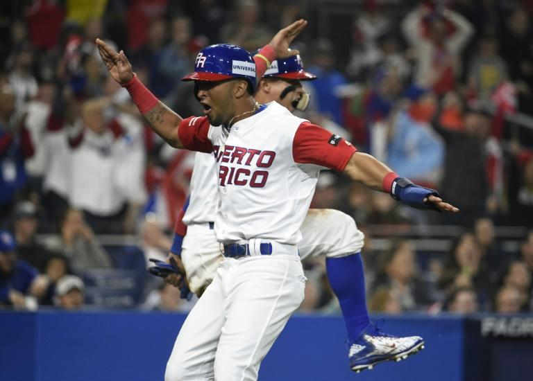 Eddie Rosario and Javier Baez of Puerto Rico celebrate after scoring during the sixth inning of their World Baseball Classic Pool F game against the US, at PETCO Park in San Diego, California, on March 17, 2017