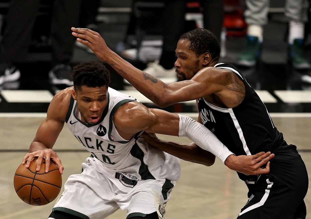 Giannis Antetokounmpo and Kevin Durant met in an instant classic Game 7 of the Eastern Conference finals. (Elsa/Getty Images)