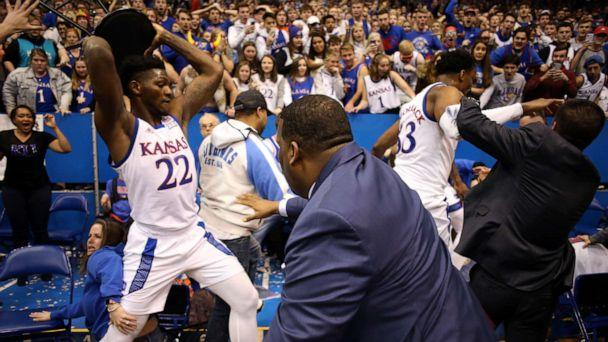 PHOTO: Silvio De Sousa #22 of the Kansas Jayhawks picks up a chair during a brawl as the game against the Kansas State Wildcats ends at Allen Fieldhouse on January 21, 2020 in Lawrence, Kansas. (Jamie Squire/Getty Images)