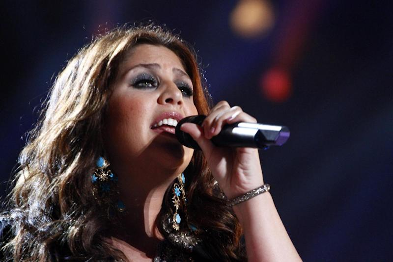 CORRECTS FAMILY NAME TO TYRRELL - FILE - This June 7, 2013 file photo shows Hillary Scott of Lady Antebellum performing on day 2 of the 2013 CMA Music festival at the LP Field in Nashville, Tenn. Scott's representative confirms the country singer gave birth to Eisele Kaye Tyrrell on Monday in Nashville. Scott is married to drummer Chris Tyrrell. Eisele is the couple's first child. (Photo by Wade Payne/Invision/AP, File)