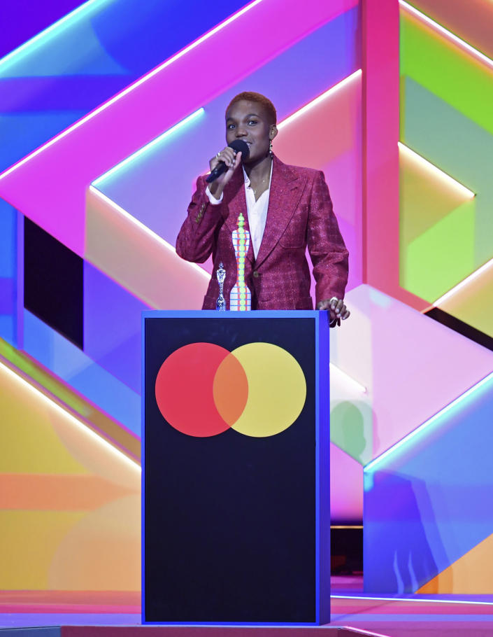 Arlo Parks accepts the award for Breakthrough Artist during the Brit Awards 2021 at the O2 Arena, London, Tuesday, May 11, 2021. (Ian West/PA via AP)