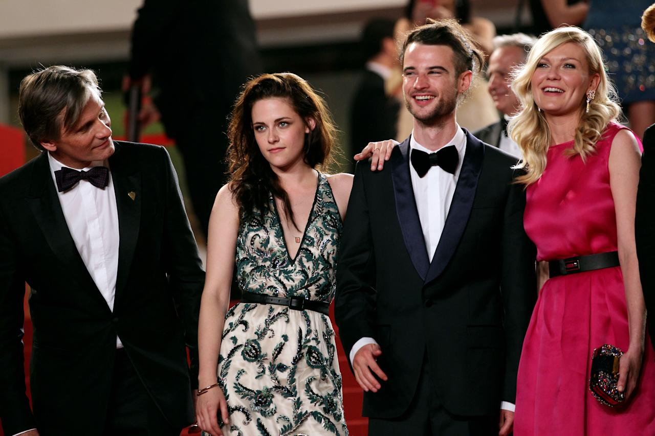 "CANNES, FRANCE - MAY 23:  (L-R) Viggo Mortensen, Kristen Stewart, Tom Sturridge and Kirsten Dunst depart the ""On The Road"" Premiere during the 65th Annual Cannes Film Festival at Palais des Festivals on May 23, 2012 in Cannes, France.  (Photo by Vittorio Zunino Celotto/Getty Images)"