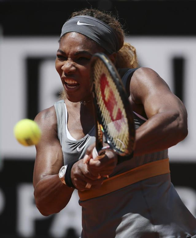 Serena Williams returns the ball to Italy's Sara Errani, during the final match against Italy's Sara Errani at the Italian open tennis tournament in Rome, Sunday, May 18, 2014. Serena Williams kept the crowd from being a factor in a 6-3, 6-0 victory over 10th-seeded Sara Errani to win the Italian Open for the third time Sunday. (AP Photo/Gregorio Borgia)