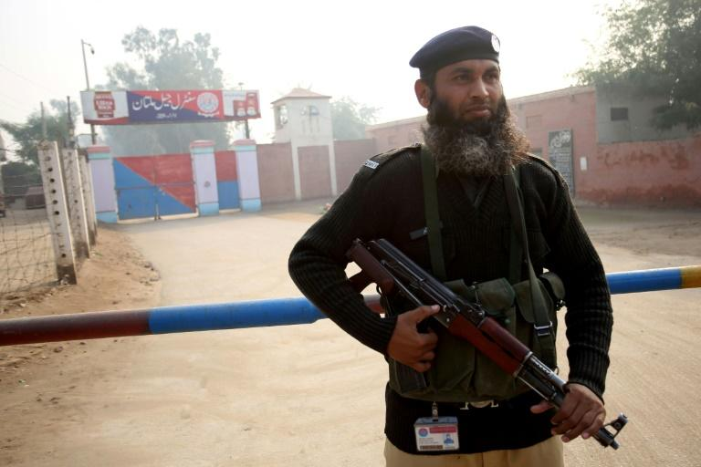 A policeman stands guard outside the central jail in Multan where Hafeez was sentenced to death