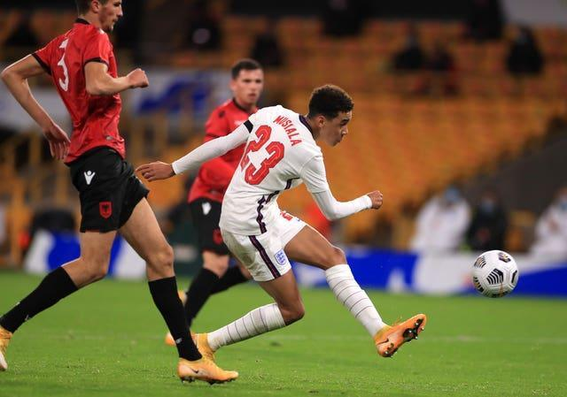 Jamal Musiala, right, scores in an England Under-21 game against Albania