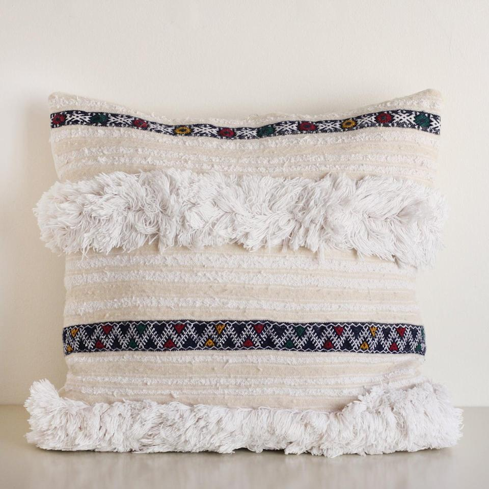 <p>This plush <span>Handira Pillow</span> ($275) will add warmth and texture to your space.</p>