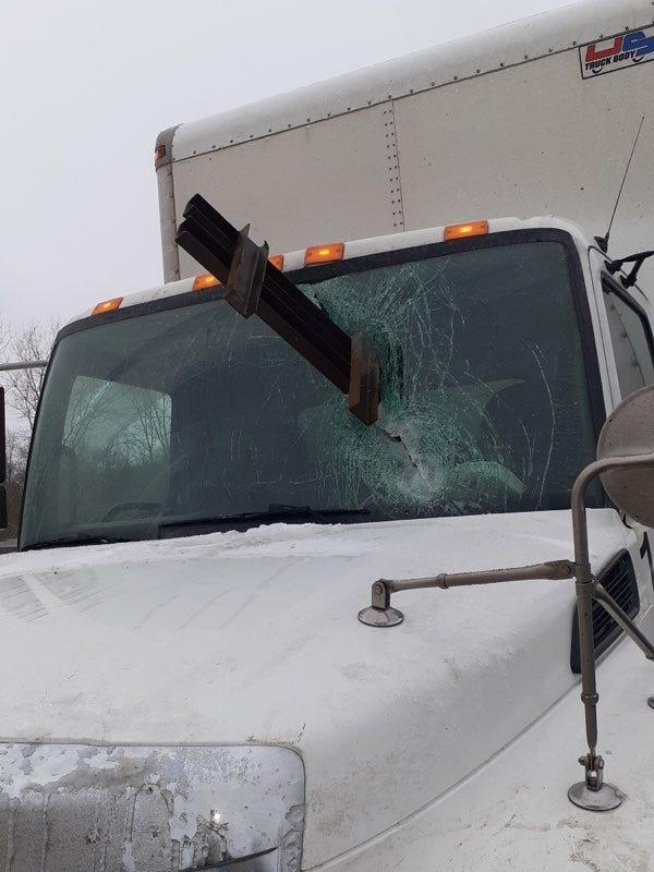 A photo provided by Johnnie Lowe shows his work truck after a beam slammed through his windshield on Thursday, Feb. 6.