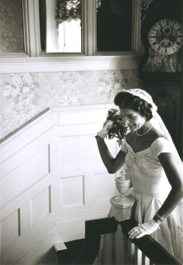 Kennedy's wedding gown was constructed out of <span>50 yards of ivory silk taffeta.</span>