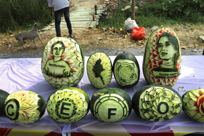 Carved watermelons showing the portrait of Aung San Suu Kyi are seen in Mandalay