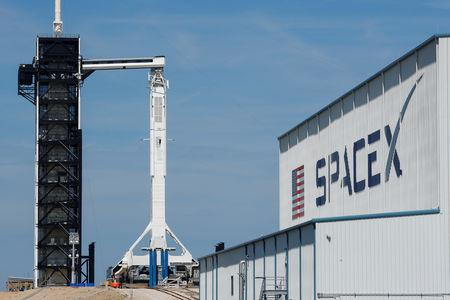 A SpaceX Falcon 9 carrying the Crew Dragon spacecraft sits on launch pad 39A prior to the uncrewed test flight to the International Space Station from the Kennedy Space Center in Cape Canaveral, Florida, U.S., March 1, 2019. REUTERS/Mike Blake