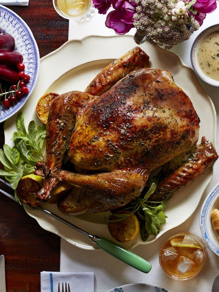 """<p>A traditional British Christmas dinner looks similar to an American Thanksgiving dinner (they don't celebrate, after all!). While the list below has British-themed dishes, such as pigs in blankets and fruitcake in the form of cookies, the way to truly make it feel authentic is to whip up a batch of Yorkshire pudding and break open some Christmas crackers.</p><p><strong>Appetizers:</strong></p><p><a href=""""https://www.countryliving.com/food-drinks/recipes/a3263/pigs-in-blanket-recipe/"""" rel=""""nofollow noopener"""" target=""""_blank"""" data-ylk=""""slk:Pigs in Blankets"""" class=""""link rapid-noclick-resp"""">Pigs in Blankets</a></p><p><strong>Main Course:</strong></p><p><a href=""""https://www.countryliving.com/food-drinks/recipes/a5944/herb-citrus-butter-roasted-turkey-recipe-clx1114/"""" rel=""""nofollow noopener"""" target=""""_blank"""" data-ylk=""""slk:Herb and Citrus Butter Roasted Turkey"""" class=""""link rapid-noclick-resp"""">Herb and Citrus Butter Roasted Turkey</a></p><p><a href=""""https://www.countryliving.com/food-drinks/recipes/a5934/thyme-pear-gravy-recipe-clx1114/"""" rel=""""nofollow noopener"""" target=""""_blank"""" data-ylk=""""slk:Thyme-Pear Gravy"""" class=""""link rapid-noclick-resp"""">Thyme-Pear Gravy</a></p><p><strong>Side Dishes:</strong></p><p><a href=""""https://www.countryliving.com/food-drinks/recipes/a4061/roasted-potatoes-fresh-herbs-recipe-clx0312/"""" rel=""""nofollow noopener"""" target=""""_blank"""" data-ylk=""""slk:Roasted Potatoes with Fresh Herbs"""" class=""""link rapid-noclick-resp"""">Roasted Potatoes with Fresh Herbs</a></p><p><a href=""""https://www.countryliving.com/food-drinks/recipes/a40026/rosemary-monkey-bread-stuffing-recipe/"""" rel=""""nofollow noopener"""" target=""""_blank"""" data-ylk=""""slk:Rosemary Monkey Bread Stuffing"""" class=""""link rapid-noclick-resp"""">Rosemary Monkey Bread Stuffing</a></p><p><a href=""""https://www.countryliving.com/food-drinks/recipes/a45288/roasted-brussels-sprouts-recipe/"""" rel=""""nofollow noopener"""" target=""""_blank"""" data-ylk=""""slk:Roasted Brussels Sprouts"""" class=""""link rapid-noclick-resp"""">Roasted Brussels Sprouts</a></p><"""