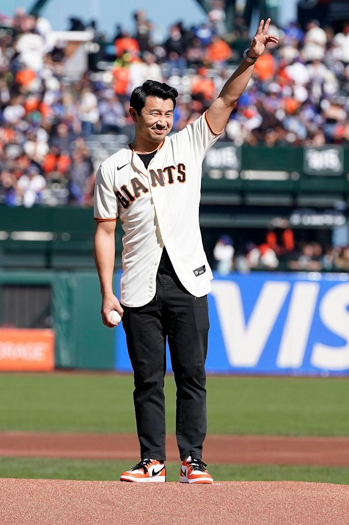 <p>Simu Liu waves to the crowd before throwing out the ceremonial first pitch before the San Francisco Giants game in San Francisco on Sept. 5. </p>