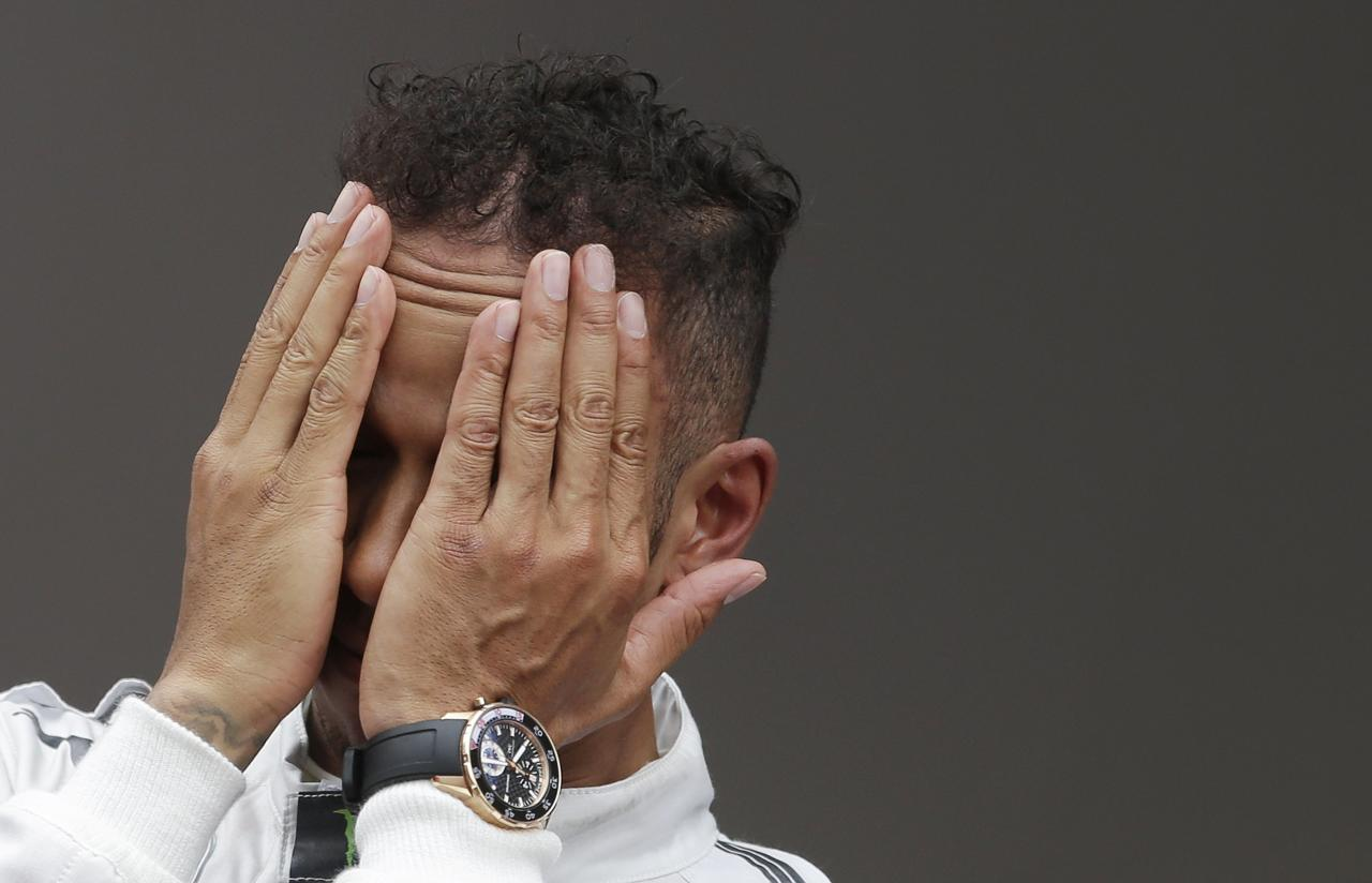 Mercedes Formula One driver Lewis Hamilton of Britain reacts on the podium after taking the second place in the Monaco Grand Prix in Monaco May 25, 2014. REUTERS/Max Rossi (MONACO - Tags: SPORT MOTORSPORT F1 TPX IMAGES OF THE DAY)