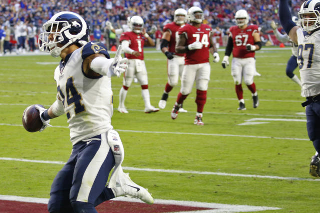Los Angeles Rams safety Taylor Rapp (24) runs back an interception for a touchdown against the Arizona Cardinals during the second half of an NFL football game, Sunday, Dec. 1, 2019, in Glendale, Ariz. (AP Photo/Ross D. Franklin)
