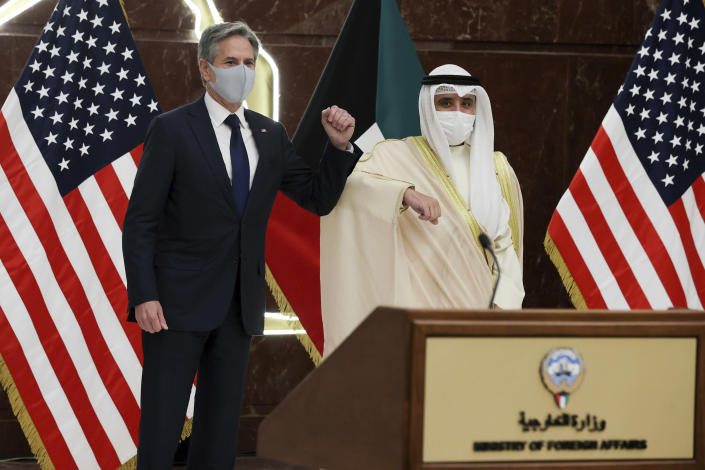 Kuwaiti Foreign Minister Sheikh Ahmad Nasser Al-Mohammad Al-Sabah and U.S. Secretary of State Antony Blinken arrive for a joint news conference at the Ministry of Foreign Affairs in Kuwait City, Kuwait, Thursday, July 29, 2021. (Jonathan Ernst/Pool via AP)