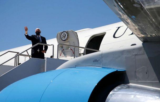 PHOTO: Vice President Mike Pence waves as he boards Air Force Two after meeting with Arizona Gov. Doug Ducey to discuss the surge in coronavirus cases in Arizona Wednesday, July 1, 2020, in Phoenix. (Ross D. Franklin/AP)