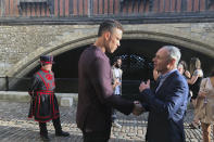 New York Yankees baseball player Aaron Judge shakes hands with baseball commissioner Ron Manfred, right, outside the Tower of London, Friday, June 28, 2019. The Boston Red Sox and New York Yankees are in London to play two games this weekend. (AP Photo/Ron Blum)