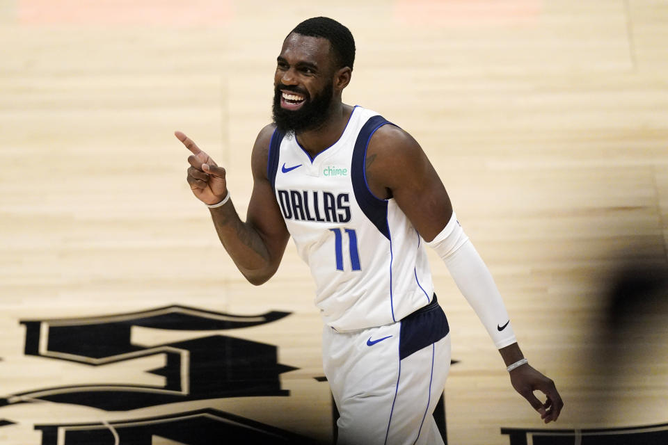 Dallas Mavericks forward Tim Hardaway Jr. celebrates during a timeout in the second half in Game 5 of an NBA basketball first-round playoff series against the Los Angeles Clippers Wednesday, June 2, 2021, in Los Angeles. (AP Photo/Mark J. Terrill)