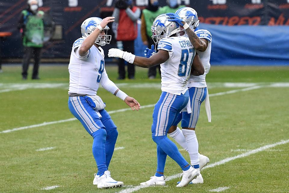 Matthew Stafford (9) is congratulated by Quintez Cephus (87) after throwing a touchdown pass against the Chicago Bears during the first half at Soldier Field on Dec. 6, 2020, in Chicago.