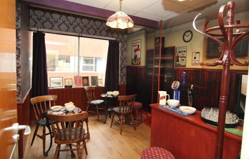 A 'memories pub' complete with replica beer taps and vintage posters at Wirrals Arrowe Park hospital (PA)