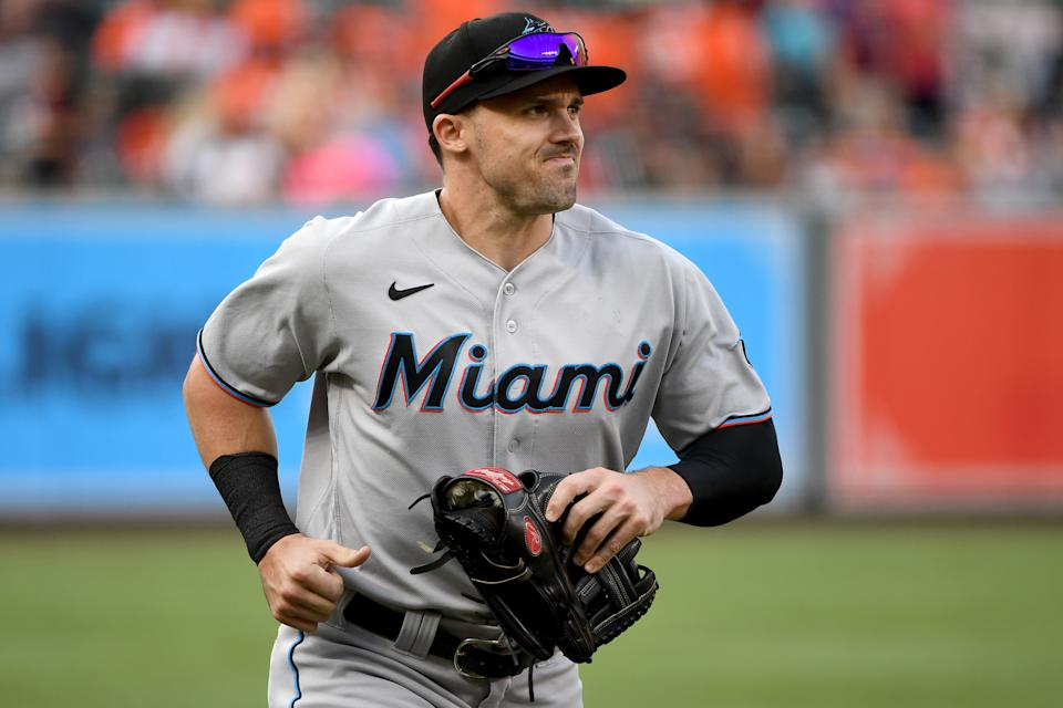 BALTIMORE, MARYLAND - JULY 27: Adam Duvall #14 of the Miami Marlins warms up prior to the game against the Baltimore Orioles at Oriole Park at Camden Yards on July 27, 2021 in Baltimore, Maryland. (Photo by Will Newton/Getty Images)
