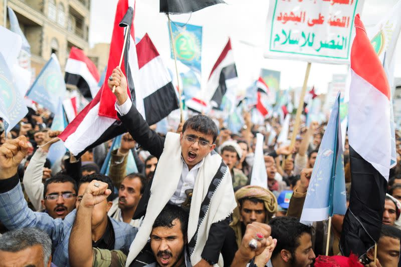 Supporters of Yemen's Houthis shout slogans during a rally to celebrate the seventh anniversary of the ousting of the government in Sanaa