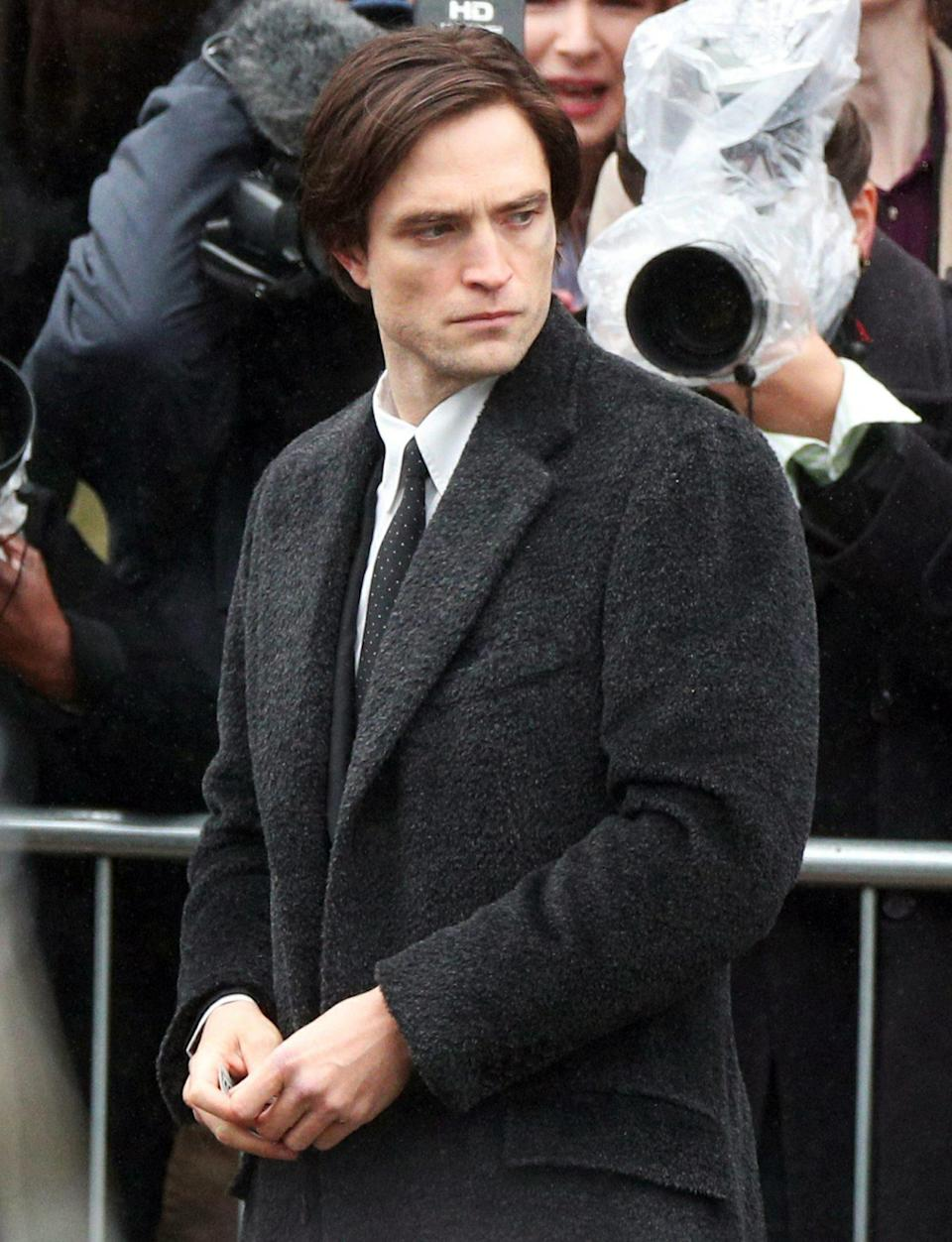 <p>Robert Pattinson is seen on Monday outside of St. George's Hall in Liverpool, London filming scenes for <em>Batman</em>.</p>