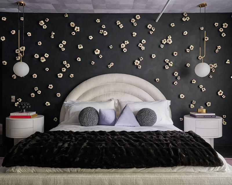 That curvaceous bed is by Kostas Upholstery; the custom bed pillows are made with textiles from Fabricut.