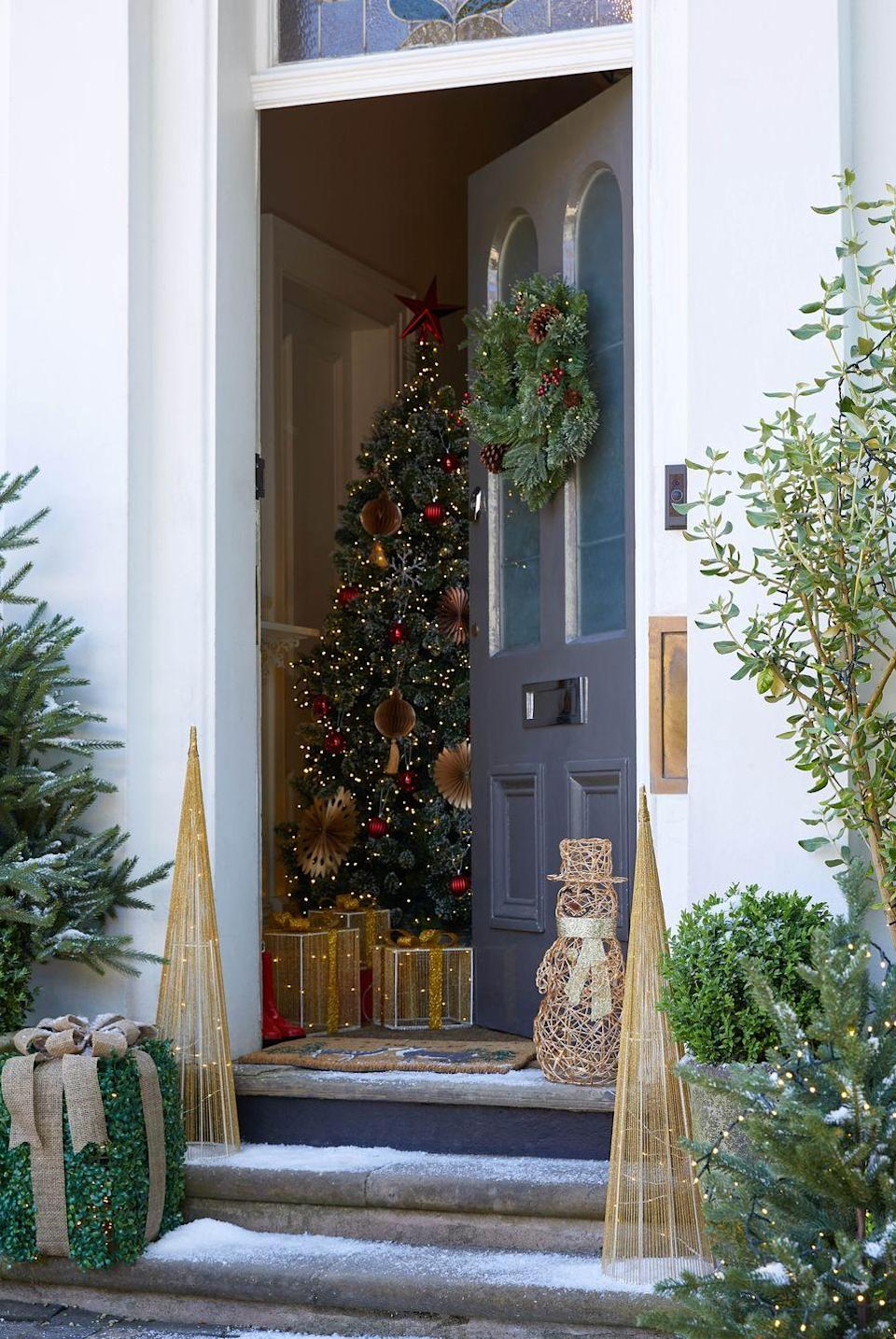 """<p><a href=""""https://www.housebeautiful.com/uk/decorate/exterior/a34140487/doorscaping-autumn-front-door-displays/"""" rel=""""nofollow noopener"""" target=""""_blank"""" data-ylk=""""slk:Doorscaping"""" class=""""link rapid-noclick-resp"""">Doorscaping</a> — one of Instagram's biggest trends — is not going anywhere this Christmas. As well as framing your doorway with foliage, why not hang a wreath on your door, place fun festive characters outside or string lights around hedges? </p>"""