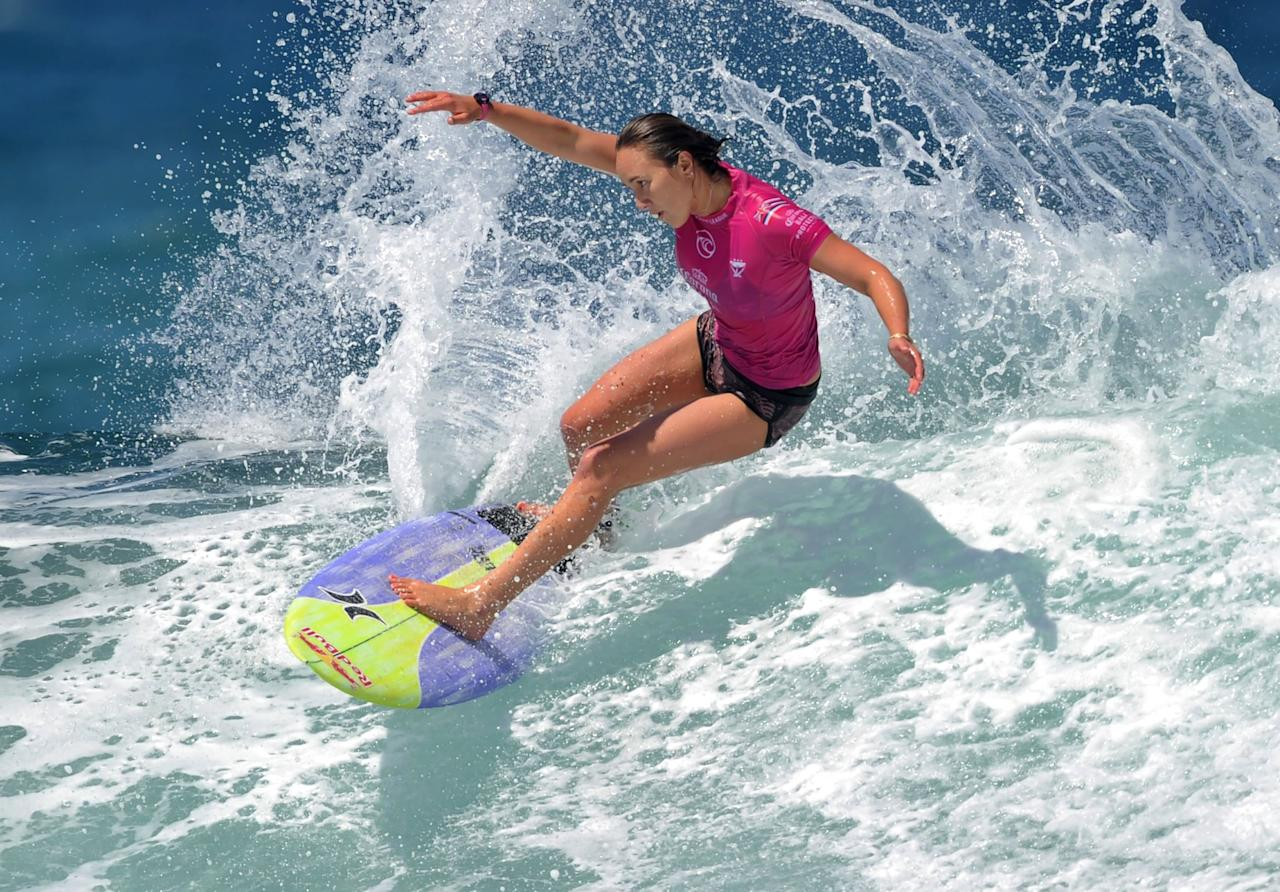 """<p>Get ready to watch the best surfers in the world compete at the 2020 Olympics. Surfing was added """"to bring more youthful and vibrant activities into the Olympic program,"""" according to<a href=""""https://tokyo2020.org/en/games/sport/olympic/surfing/"""" target=""""_blank"""" class=""""ga-track"""" data-ga-category=""""Related"""" data-ga-label=""""https://tokyo2020.org/en/games/sport/olympic/surfing/"""" data-ga-action=""""In-Line Links"""">the Tokyo 2020 website</a>.<br></p> <p>There are a variety of boards that can be used to surf but at the 2020 Olympics, the 20 men and 20 women competitors will be required to use a shortboard.<br></p> <p>Four athletes will compete at a time, and the best two will advance to the next round. The heat lengths will depend on the condition of the waves but will last around 20 to 30 minutes. Athletes will be able to ride 10 to 12 waves in that time frame and their two highest scores will be counted.<br></p> <p>A panel of judges will determine the winners in both the men's and women's competition. Scoring is based on the type and difficulty of the maneuvers performed along with the speed, power, and flow. </p> <p><strong>Male competitors to watch:</strong> John John Florence, Gabriel Medina, Adriano De Souza, and Kolohe Andino.<br> <strong>Female competitors to watch:</strong> Tyler Wright, Stephanie Gilmore, Sally Fitzgibbons, and Carissa Moore.</p>"""