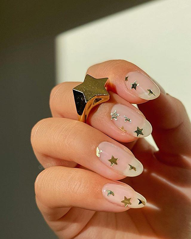 """<p>Simple gold stars on bare nails makes for a modern twist on a classic romantic manicure.</p><p><a href=""""https://www.instagram.com/p/CC35t8KDJid/?utm_source=ig_embed&utm_campaign=loading"""" rel=""""nofollow noopener"""" target=""""_blank"""" data-ylk=""""slk:See the original post on Instagram"""" class=""""link rapid-noclick-resp"""">See the original post on Instagram</a></p>"""
