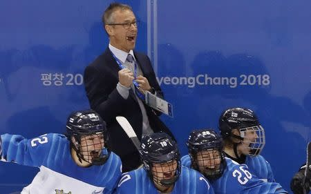 Ice Hockey - Pyeongchang 2018 Winter Olympics - Women's Bronze Medal Match - Finland v Olympic Athletes from Russia - Kwandong Hockey Centre, Gangneung, South Korea - February 21, 2018 - Finland coach Pasi Mustonen celebrates after the match. REUTERS/Kim Kyung-Hoon