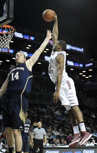 Saint Joseph's Ronald Roberts Jr., drives the ball to the basket against Notre Dame Scott Martin (14) in the second half of the Coaches vs. Cancer Classic basketball game on Friday, Nov., 16, 2012, at Barclays Center in New York. (AP Photo/Kathy Kmonicek)