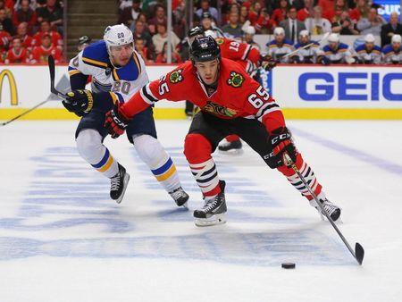 Apr 23, 2016; Chicago, IL, USA; Chicago Blackhawks center Andrew Shaw (65) is pursued by St. Louis Blues left wing Alexander Steen (20) during the first period in game six of the first round of the 2016 Stanley Cup Playoffs at the United Center. Mandatory Credit: Dennis Wierzbicki-USA TODAY Sports